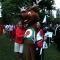 Arciere in posa con la mascotte M'arco